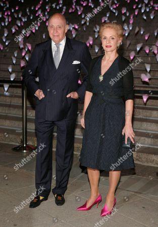 Fashion designer Carolina Herrera, right, with her husband Reinaldo Herrera, left, attends the Vanity Fair Tribeca Film Festival Party,, in New York