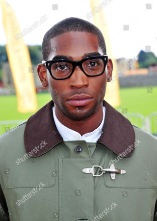 Stock Image of Tiny Tempah poses at the Veuve Clicquot Gold Cup Polo at Cowdrey Park on in Midhurst