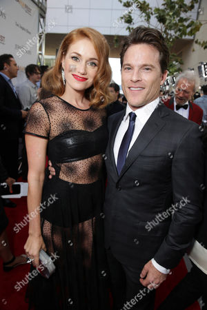 Stock Picture of Erica Piccininni and Mike Doyle seen at the Warner Bros. Premiere of 'Jersey Boys' at the 2014 Los Angeles Film Festival held at Regal Cinemas LA Live Stadium 14, in Los Angeles