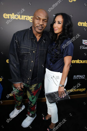 "Mike Tyson and Lakiha Spicer seen at Warner Bros. Premiere of ""Entourage"" held at Regency Village Theatre, in Westwood, Calif"