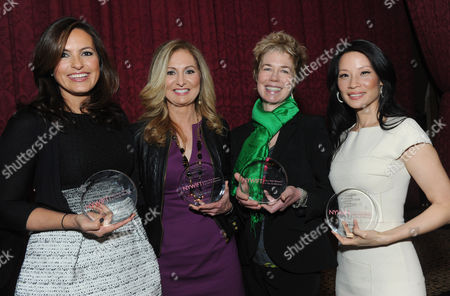 Actress Mariska Hargitay, left, WE tv President and General Manager Kim Martin, second left, documentary filmmaker Lisa F. Jackson, second right, and actress Lucy Liu pose together after being honored at the 32nd annual Muse Awards presented by New York Women in Film & Television (NYWIFT), in New York