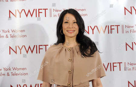 Stock Picture of Lucy Liu is honored at the 32nd annual Muse Awards presented by New York Women in Film & Television (NYWIFT), in New York. The event also honored actress Mariska Hargitay, Kim Martin, President & General Manager WE tv, Lisa F. Jackson, documentary filmmaker, and Debra Zimmerman, of Women Make Movies