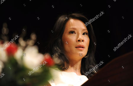 Stock Photo of Lucy Liu is honored at the 32nd annual Muse Awards presented by New York Women in Film & Television (NYWIFT), in New York. The event also honored actress Mariska Hargitay, Kim Martin, President & General Manager WE tv, Lisa F. Jackson, documentary filmmaker, and Debra Zimmerman, of Women Make Movies
