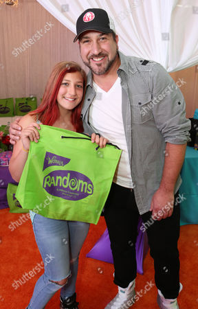 Stock Image of Joey Fatone, right, and Briahna Joely Fatone stop by the Wango Tango gifting suite to taste the new Randoms candy by Wonka at StubHub Center, in Carson, Calif