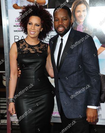 "David E. Talbert, right, and Lyn Talbert arrive at the world premiere of ""Baggage Claim"" at the Premiere House at Regal Cinemas L.A. Live on in Los Angeles"