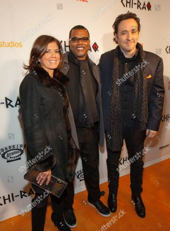 Stock Photo of Zoraida Sambolin, Kenny Williams and John Cusack at the world premiere of â?œChi-Raqâ?? at the Chicago Theatre on in Chicago