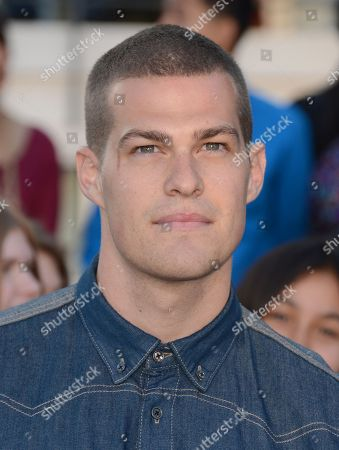 """Stock Picture of Greg Finley arrives at the world premiere of """"Divergent"""" at the Westwood Regency Village Theater, in Los Angeles"""