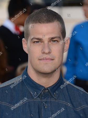 """Greg Finley arrives at the world premiere of """"Divergent"""" at the Westwood Regency Village Theater, in Los Angeles"""
