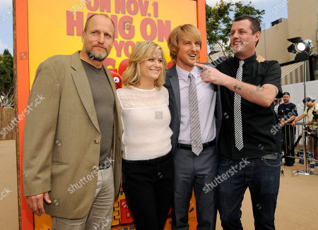"""Stock Photo of Jimmy Hayward, far right, writer/director of """"Free Birds,"""" poses with cast members, left to right, Woody Harrelson, Amy Poehler and Owen Wilson at the world premiere of the film at the Regency Village Theater, in Los Angeles"""