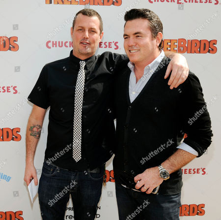 """Stock Image of Tucker Tooley, right, president of Relativity Media, mingles with writer/director Jimmy Hayward at the world premiere of """"Free Birds"""" at the Regency Village Theater on in Los Angeles"""