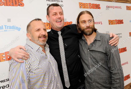 "Jimmy Hayward, center, writer/director of ""Free Birds,"" poses with executive producer Aron Warner, left, and writer/producer Scott Mosier at the world premiere of the film at the Regency Village Theater on in Los Angeles"