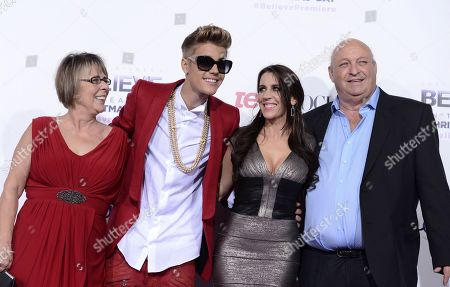 "Singer Justin Bieber, second from left, poses with grandmother Diane Dale, left, his mother Pattie Mallette, second from right, and his grandfather Bruce Dale at the premiere of the feature film ""Justin Bieber's Believe"" at Regal Cinemas L.A. Live, in Los Angeles"