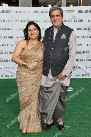 "Apara Mehta, left, and Darshan Jariwala arrive at the world premiere of ""Million Dollar Arm"" on in Los Angeles"