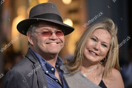 """Micky Dolenz, left, and Donna Quinter arrive at the world premiere of """"Million Dollar Arm"""" on in Los Angeles"""