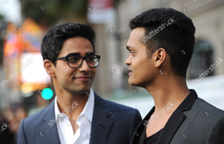 """Stock Picture of Suraj Sharma, left, and Madhur Mittal arrive at the world premiere of """"Million Dollar Arm"""" at El Capitan Theatre, in Los Angeles"""