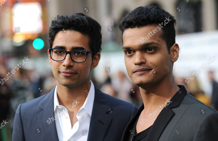 """Suraj Sharma, left, and Madhur Mittal arrive at the world premiere of """"Million Dollar Arm"""" at El Capitan Theatre, in Los Angeles"""