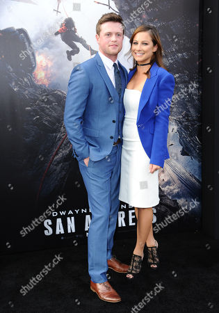 "Hugo Johnstone-Burt, left, and Romy Poulier arrive at the world premiere of ""San Andreas"" at the TCL Chinese Theatre, in Los Angeles"