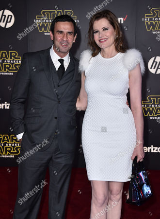 """Reza Jarrahy, left, and Geena Davis arrive at the world premiere of """"Star Wars: The Force Awakens"""" at the TCL Chinese Theatre, in Los Angeles"""
