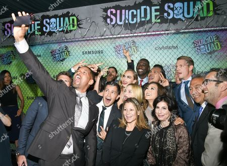 "Actors Will Smith, left, Jay Hernandez, Margot Robbie, Cara Delevingne, Adam Beach and Adewale Akinnuoye-Agbaje pose for selfie on the rd carpet at the world premiere of ""Suicide Squad"" at the Beacon Theatre, in New York"
