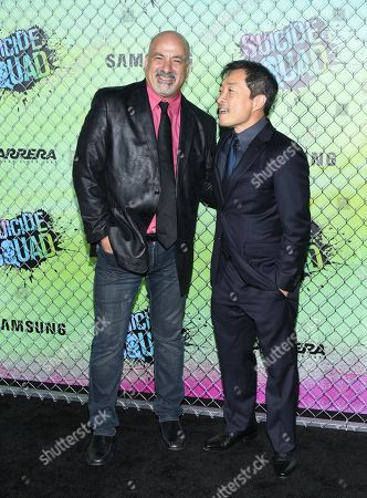 """Writer and DC Comics co-publishers Dan DiDio, left, and Jim Lee attend the world premiere of """"Suicide Squad"""" at the Beacon Theatre, in New York"""