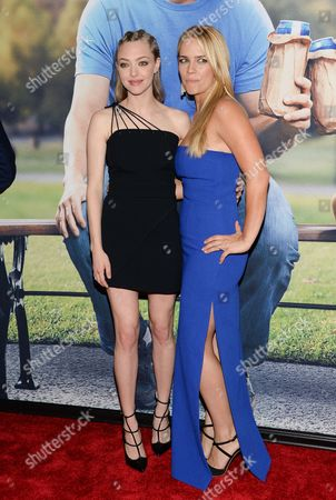 """Actresses Amanda Seyfried, left, and Jessica Barth attend the world premiere of """"Ted 2"""" at the Ziegfeld Theatre, in New York"""