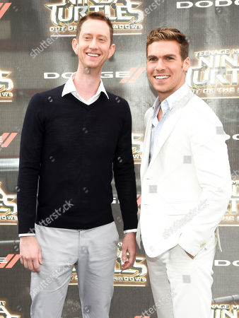 """Jeremy Howard, left, and Pete Ploszek, right, attend the world premiere of """"Teenage Mutant Ninja Turtles: Out of the Shadows"""" at Madison Square Garden, in New York"""