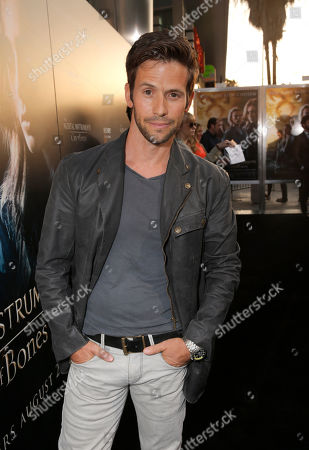 """Christian Oliver arrives on the red carpet at the world premiere of """"The Mortal Instruments: City of Bones"""" at the ArcLight Cinerama Dome on in Los Angeles"""
