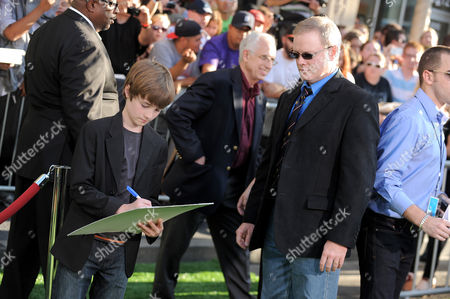 "CJ Adams, on the left, and his father attend the world premiere of ""The Odd Life of Timothy Green"" at The El Capitan Theatre on in Los Angeles"