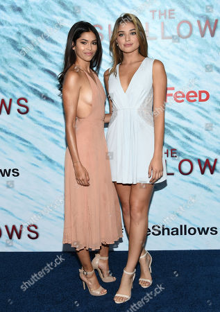"""Models Juliana Herz, left, and Daniela Lopez attend the world premiere of """"The Shallows"""" at AMC Loews Lincoln Square, in New York"""