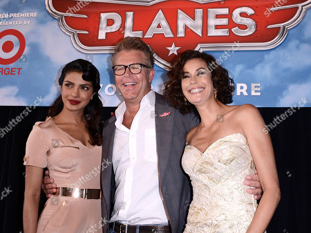 """From left to right, actress Priyanka Chopra, director Klay Hall and actress Teri Hatcher arrive on the red carpet of the world premiere of Disney's """"Planes"""" at the El Capitan Theatre on Monday, August, 5, 2013 in Los Angeles"""