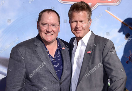"""Stock Photo of From left to right, executive John Lasseter and director Klay Hall arrive on the red carpet of the world premiere of Disney's """"Planes"""" at the El Capitan Theatre on Monday, August, 5, 2013 in Los Angeles"""