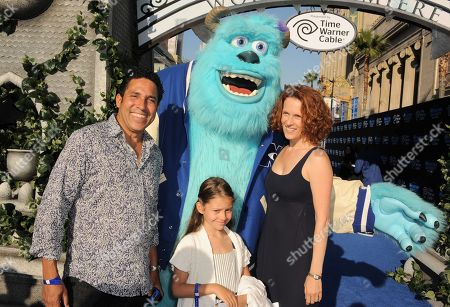 "Oscar Nunez, left, Ursula Whittaker, right, and guest arrive at the world premiere of ""Monsters University"" at the El Capitan Theatre, in Los Angeles"