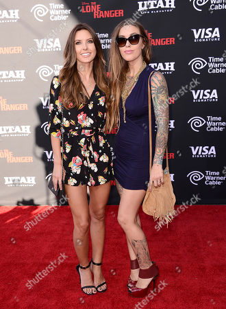 """Actress Audrina Patridge and sister Casey Patridge arrive at the world premiere of """"The Lone Ranger"""" at Disney California Adventure on in Anaheim, Calif"""