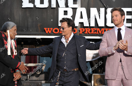 "From left, Saginaw Grant, Johnny Depp, and Armie Hammer appear on stage at the world premiere of ""The Lone Ranger"" at Disney California Adventure on in Anaheim, Calif"