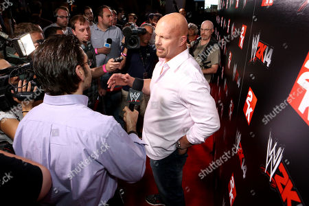WWE Hall of Famer Stone Cold Steve Austin speaks with media at the WWE 2K14 press event, on in Los Angeles