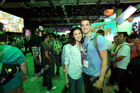 Stock Photo of Rick Malambri, right, and his wife Lisa Mae interact with newly announced games and experiences at the Xbox booth at E3 2014 in Los Angeles on