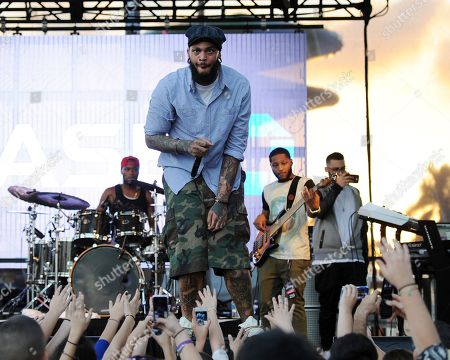 Travie McCoy attends Y100's Jingle Ball 2013 at BB&T Center on in Miami, Florida