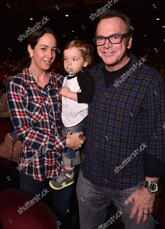 Ashley Groussman, and from left, Jax Arnold and Tom Arnold attend Yo Gabba Gabba! LIVE! Music Is Awesome! at the Shrine Auditorium, in Los Angeles