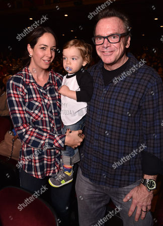 Stock Image of Ashley Groussman, and from left, Jax Arnold and Tom Arnold attend Yo Gabba Gabba! LIVE! Music Is Awesome! at the Shrine Auditorium, in Los Angeles
