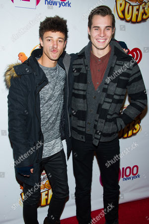 Cameron Dallas and Marcus Johns pose in the Z100 Jingle Ball press room at Madison Square Garden, in New York