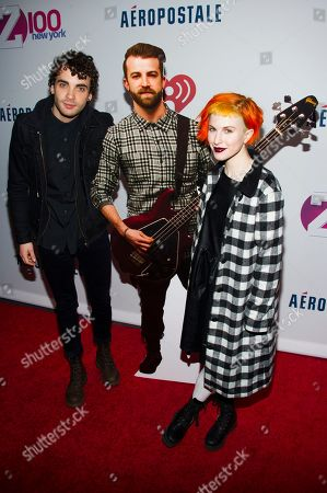 Paramore band members Taylor York, left, and Hayley Williams, right, pose with a cardboard cut-out of absent bassist Jeremy Davis at Z100's Jingle Ball presented by Aeropostale, in New York