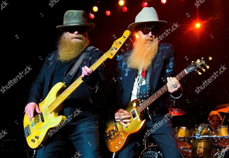 ZZ Top, left to right, Dusty Hill, Billy Gibbons and Frank Beard perform at Blue Hills Bank Pavilion, in Boston