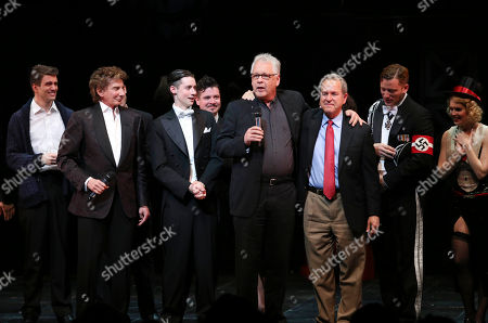 """Stock Picture of From left, cast member Shayne Kennon, Composer Barry Manilow, cast members Chris Dwan and Will Blum, Book and Lyrics Writer Bruce Sussman, Comedian Harmonist Erich Collin's grandson Marc Alexander, cast member Chad Lindsey and cast member Lauren Elaine Taylor speak during the curtain call after the opening night performance of """"Harmony"""" at Center Theatre Group/Ahmanson Theatre, in Los Angeles, Calif"""
