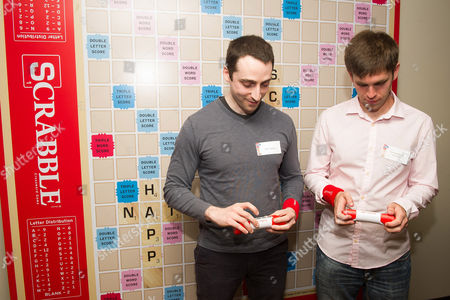 National SCRABBLE Champion Conrad Bassett-Bouchard, right, and competitive SCRABBLE player Will Anderson play the SCRABBLE TWIST game during the National SCRABBLE Day event hosted by Hasbro at the Ace Hotel, on in New York
