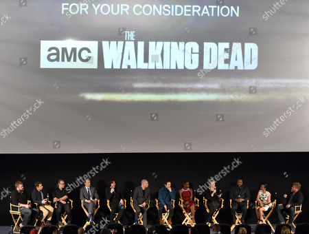 "Robert Kirkman, and from left, Scott M. Gimple, Gregory Nicotero, Andrew Lincoln, Norman Reedus, Dominic Patten,Steven Yeun, Danai Gurira, Melissa McBride, Chad Coleman, Sonequa Martin-Green and Michael Cudlitz are seen at ""The Walking Dead"" ATAS FYC event at the Egyptian Theater on in Los Angeles"