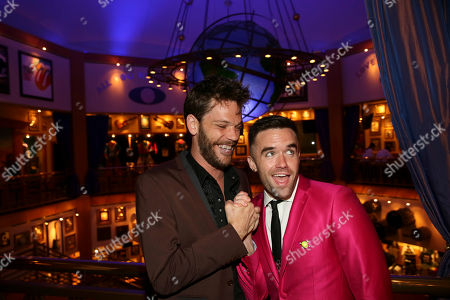 """From left, cast members Ryan Knowles and Brian Justin Crum pose during the party for the opening night performance of Queen and Ben Elton's """"We Will Rock You"""" at the Center Theatre Group/Ahmanson Theatre, in Los Angeles, Calif"""