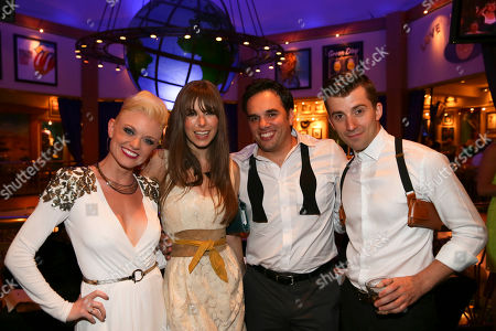 """From left, cast members Ruby Lewis, Katie Murphy, Danny Balkwil and Daniel Greenberg pose during the party for the opening night performance of Queen and Ben Elton's """"We Will Rock You"""" at the Center Theatre Group/Ahmanson Theatre, in Los Angeles, Calif"""