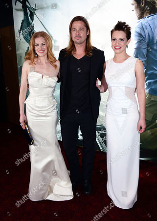 Mireille Enos, Brad Pitt and Daniella Kertesz arrive at the World Premiere of 'World War Z' at the Empire Cinema in London, Sunday June 2nd, 2013