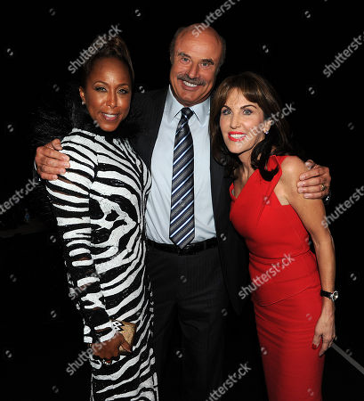 Marjorie Bridges (L), Dr. Phil McGraw (C), and his wife Robin McGraw backstage at the 11th Annual Ford Neighborhood Awards, on at the MGM Grand Garden Arena in Las Vegas, Nevada