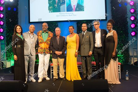 L-R) Soledad O'Brien, Russell Simmons, Danny Simmons, Michael Bloomberg, Carrie Mae Weems, Valentino D. Carlotti, Jason Flom and Tangie Murray pose on stage the Rush Philanthropic Arts Foundation's 15th Annual Art for Life Benefit at Fairview Farms in Water Mill, in New York